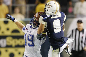 photo -   Georgia Tech running back Tony Zenon (9) pulls in a catch over Presbyterian safety J.J. Russell (49) during the second half of an NCAA college football game, Saturday, Sept. 8, 2012, in Atlanta. (AP Photo/John Bazemore)