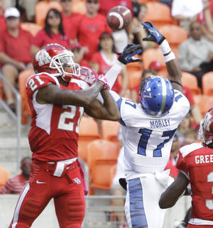 Photo - Memphis' Chris Morley, right, breaks up pass intended for Houston' Markeith Ambles, left, during the second quarter of an NCAA college football game at BBVA Compass Stadium Saturday, Oct. 12, 2013, in Houston.  (AP Photo/Houston Chronicle, Melissa Phillip)