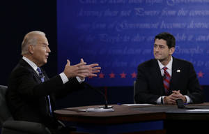 Photo -   Republican vice presidential nominee Rep. Paul Ryan, of Wisconsin, right, listens as Vice President Joe Biden speaks during the vice presidential debate at Centre College, Thursday, Oct. 11, 2012, in Danville, Ky. (AP Photo/Eric Gay)