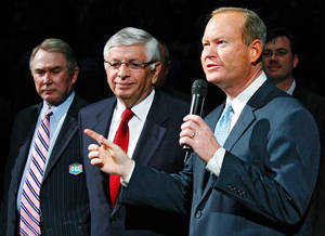 Photo - FINAL REGULAR SEASON HOME GAME: Oklahoma City mayor Mick Cornett addresses the fans alongside Hornets owner Geroge Shinn and NBA Commissioner David Stern before the start of the NBA basketball game between the New Orleans/Oklahoma City Hornets and the Denver Nuggets at the Ford Center in Oklahoma City, Friday, April 13, 2007. By Nate Billings, The Oklahoman  ORG XMIT: KOD