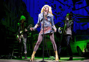 "Photo - FILE - This file image released by Boneau/Bryan-Brown shows Neil Patrick Harris in a scene from ""Hedwig and the Angry Inch,"" at the Belasco Theatre in New York. ""Hedwig and the Angry Inch,"" a cult off-Broadway hit, won eight Tony nominations on Tuesday, April 29, 2014. (AP Photo/Boneau/Bryan-Brown, Joan Marcus, File)"