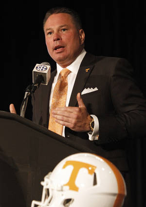 Photo - Tennessee coach Butch Jones speaks to the media at the Southeastern Conference NCAA college football media days, Tuesday, July 15, 2014, in Hoover, Ala. (AP Photo/Butch Dill)