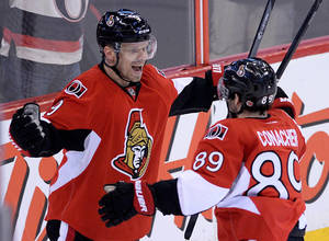 Photo - Ottawa Senators' Milan Michalek, left, celebrates a first-period goal with teammate Cory Conacher against the Winnipeg Jets during an NHL hockey game in Ottawa, Ontario, on Thursday, Jan. 2, 2014. (AP Photo/The Canadian Press, Sean Kilpatrick)
