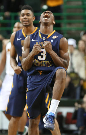 Photo - West Virginia guard Juwan Staten (3) reacts to his game winning basket against Baylor in the second half of an NCAA college basketball game, Tuesday, Jan. 28, 2014, in Waco, Texas. West Virginia won 66-64. (AP Photo/Waco Tribune Herald, Rod Aydelotte)