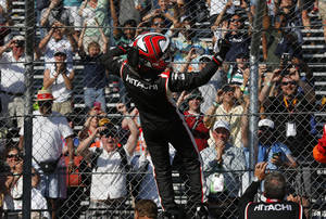 Photo - Helio Castroneves celebrates winning the second race of the IndyCar Detroit Grand Prix auto racing doubleheader in Detroit Sunday, June 1, 2014. (AP Photo/Paul Sancya)