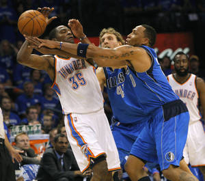 photo - Oklahoma City's Kevin Durant (35) is defended by Dirk Nowitzki (41) and Shawn Marion (0) of Dallas  during game 4 of the Western Conference Finals in the NBA basketball playoffs between the Dallas Mavericks and the Oklahoma City Thunder at the Oklahoma City Arena in downtown Oklahoma City, Monday, May 23, 2011. Photo by John Clanton, The Oklahoman