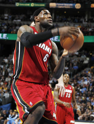 photo -   Miami Heat forward LeBron James drives the lane for a shot against the Denver Nuggets in the first quarter of an NBA basketball game in Denver on Thursday, Nov. 15, 2012. (AP Photo/David Zalubowski)