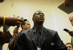 Photo - Kansas State running back Daniel Thomas answers questions during Big 12 Media Days in Irving, Texas. AP PHOTO
