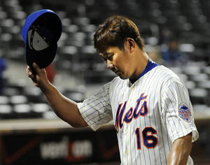 Photo - New York Mets starting pitcher Daisuke Matsuzaka tips his cap to the fans after being taken ou in the top of the eighth of Game 2 of a baseball doubleheader against the Miami Marlins at Citi Field, Saturday, Sept. 14, 2013, in New York. (AP Photo/Kathy Kmonicek)