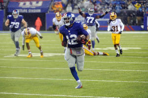 Photo - New York Giants wide receiver Jerrel Jernigan (12) runs for a touchdown during the second half of an NFL football game against the Washington Redskins, Sunday, Dec. 29, 2013, in East Rutherford, N.J. (AP Photo/Bill Kostroun)