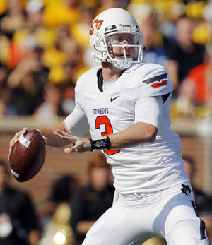 Photo - Oklahoma State's Brandon Weeden (3) passes the ball during a college football game between the Oklahoma State University Cowboys (OSU) and the University of Missouri Tigers (Mizzou) at Faurot Field in Columbia, Mo., Saturday, Oct. 22, 2011. Photo by Nate Billings, The Oklahoman