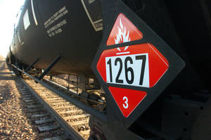 Photo - A warning placard on a tank car carrying crude oil is seen on a train idled on the tracks near a crude loading terminal Nov. 6 in Trenton, N.D. The transport of oil by rail has expanded more than thirty-fold since 2009, delivering higher prices for oil companies able to access  coastal refineries but also raising concerns about spills. AP Photo <strong>Matthew Brown</strong>