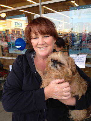 photo - Crystal Maib, founder of Orphaned Angels Rescue, holds Ada, a dog in her rescue program. Photo provided