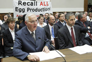 "Photo -   FILE - In this Sept. 22, 2010, file photo protestors unfurl a banner on Capitol Hill in Washington as Wright County Egg owner Austin DeCoster, left, testifies before the House Oversight and Investigations subcommittee hearing on The Outbreak of Salmonella in Eggs. An Iowa State University scientist found evidence that sick hens at farms owned by DeCoster were ""almost certainly"" laying eggs contaminated with salmonella months before one of the nation's largest outbreaks of food-borne illness came to light, newly released records show. (AP Photo/Manuel Balce Ceneta)"