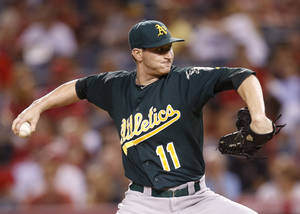 Photo -   Oakland Athletics starting pitcher Jarrod Parker throws in the first inning of a baseball game against the Los Angeles Angels in Anaheim, Calif., Monday, Sept. 10, 2012. (AP Photo/Jae C. Hong)