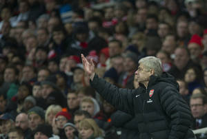 Photo - Arsenal's manager Arsene Wenger reacts during their English Premier League soccer match against Swansea City, at the Emirates Stadium, in London, Saturday, Dec. 1, 2012. (AP Photo/Bogdan Maran)