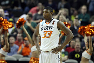 photo - OSU's Marcus Smart during last minutes of game against Oregon in the second round of the NCAA Basketball tournament in San Jose, CA, Mar. 21, 2013. STEPHEN PINGRY/Tulsa World
