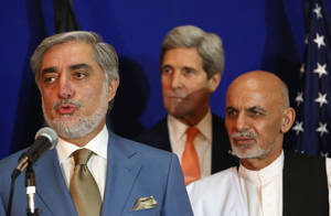 """Photo - Afghan presidential candidate Abdullah Abdullah, from left, speaks as U.S. Secretary of State John Kerry and another candidate Ashraf Ghani Ahmadzai listen during a joint press conference in Kabul, Afghanistan, Friday, Aug. 8, 2014. Abdullah called the agreement on the disputed presidential election """"another step forward in the interests of strengthening national unity in the country, strengthening rule of law in the country and bringing hope to the people for the future of Afghanistan."""" (AP Photo/Rahmat Gul)"""