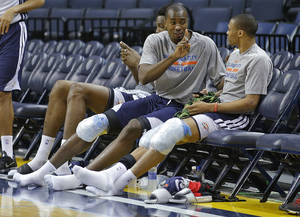 Photo - Oklahoma City's Serge Ibaka talks with Russel Westbrook at the end of practice at FedExForum in Memphis, Tenn., Friday, April 25, 2014. The Oklahoma City Thunder will play the Memphis Grizzlies in Game 4 during the first round of NBA playoffs on Saturday, April 26, 2014. Photo by Bryan Terry, The Oklahoman