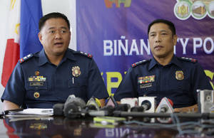 Photo - Philippine Police Superintendent Noel Calderon Alino, left, answers questions from reporters beside Senior Supt. Romulo Sapitula at a police station in Binan, Laguna province, south of Manila, Philippines on Monday, April 7, 2014. The police officials said Monday they have detained and filed a complaint of child trafficking against a vacationing Italian diplomat found at a resort south of Manila allegedly in the company of three street boys aged 9 to 12. (AP Photo/Aaron Favila)