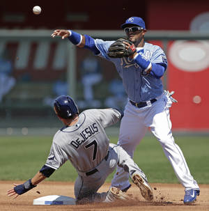 Photo - Kansas City Royals second baseman Emilio Bonifacio throws to first for the double play hit into by Tampa Bay Rays' Evan Longoria after forcing David DeJesus (7) out at second during the first inning of a baseball game Monday, Aug. 26, 2013, in Kansas City, Mo. (AP Photo/Charlie Riedel)