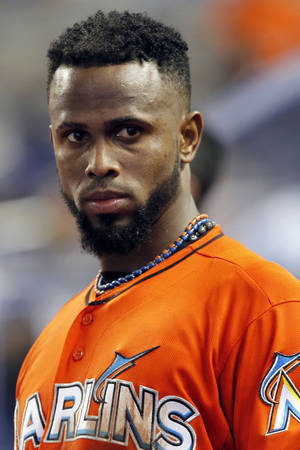 Photo -   FILE - In this Sept. 2, 2012, file photo, Miami Marlins shortstop Jose Reyes appears in the dugout during a baseball game against the New York Mets in Miami. A person familiar with the deal told The Associated Press on condition of anonymity Tuesday, Nov. 13, that the Marlins have traded Reyes to the Toronto Blue Jays. (AP Photo/Alan Diaz, File)