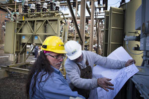 photo -   Workers inspect a transformer box at a substation on Harrison and 2nd Street as surrounding neighborhoods remain without power due to damage caused by Superstorm Sandy, Sunday, Nov. 4, 2012, in Hoboken, New Jersey. Hiring in the long-depressed U.S. construction industry will likely get a boost from the rebuilding that will follow Superstorm Sandy. Those jobs, in turn, could raise economic growth, analysts say. (AP Photo/ John Minchillo)