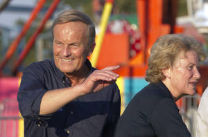 "Photo -   Senate candidate Rep. Todd Akin, R-Mo., campaigns his wife Lulli, right, during the Northwest Missouri State Fair in Bethany, Mo., Thursday, Aug. 30, 2012. It was Akin's first public interaction with voters since his Aug. 19 comment in a TV interview that women's bodies have ways of averting pregnancy from what he called ""legitimate rape."" The comment prompted widespread backlash, with some Republicans urging him to quit the race against Democratic Sen. Claire McCaskill. (AP Photo/Orlin Wagner)"