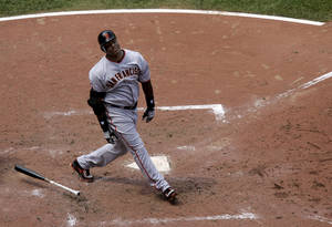 photo - FILE - This July 8, 2007 file photo shows San Francisco Giants' Barry Bonds reacting to flying out during the sixth inning of a baseball game in St. Louis. With the cloud of steroids shrouding many candidacies, baseball writers may fail for the only the second time in more than four decades to elect anyone to the Hall, Wednesday, Jan. 9, 2013. (AP Photo/Jeff Roberson, File)