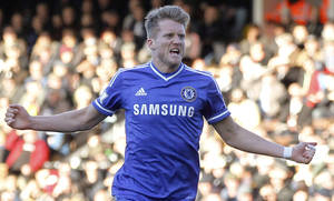 Photo - Chelsea's Andre Schurrle celebrates his goal against Fulham during their English Premier League soccer match at Craven Cottage, London, Saturday, March 1, 2014. (AP Photo/Sang Tan)