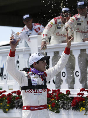 Photo - Kyle Larson celebrates his win in the ARCA racing series Pocono ARCA 200 auto race at Pocono Raceway on Saturday, June 7, 2014, in Long Pond, Pa. (AP Photo/Mike Groll)