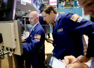 Photo -   In a photo made Thursday, Sept. 6, 2012, traders work the floor of the New York Stock Exchange. This week Federal Reserve officials will meet and are expected to announce steps to prop up the ailing U.S. economy. (AP Photo/David Karp)