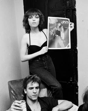 "Photo - Pat Benatar holds a copy of JAM magazine after playing the Boomer Theatre in Norman in 1979. Benatar's husband, Neil Giraldo, known as ""Spyder"" on stage, is sitting in front. Photo provided by Vernon Gowdy III"