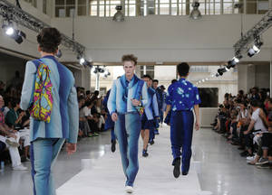 Photo - Models wear creations by Japanese fashion designer Yusuke Takahashi for Issey Miyake's men's spring-summer 2015 fashion collection presented in Paris, France, Thursday, June 26, 2014. (AP Photo/Jacques Brinon)