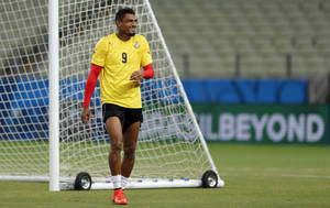 Photo - Ghana's Kevin-Prince Boateng laughs during an official training session the day before the group G World Cup soccer match between Germany and Ghana at the Arena Castelao in Fortaleza, Brazil, Friday, June 20, 2014. (AP Photo/Matthias Schrader)