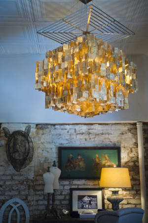 Photo - A natural shell chandelier in the bedroom of Christian Siriano's New York City apartment is featured, September 11, 2012. (Karl Merton Ferron/Baltimore Sun/MCT)