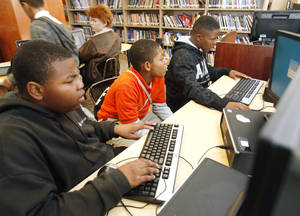 photo - Marquon Butler, left, Kijuan Cobb, and Dayquann Ervin work on a creative project, as Oklahoma City Public Schools wraps up intersession classes at Douglass High School in Oklahoma City, OK, Tuesday, October 23, 2012,  By Paul Hellstern, The Oklahoman