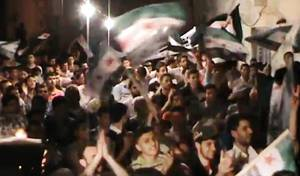 Photo -   This image made from amateur video and released by the Syria media center Tuesday, May 1, 2012, purports to show Syrians chanting slogans during a demonstration in Aleppo, Syria. On Wednesday, activists north of the northern city of Aleppo said troops were engaged in intense clashes with army defectors and rebels in the village of al-Raai. An activist who identified himself by his first name Ammar said the clashes began at night and were continuing Wednesday. (AP Photo/Syria Media Center via APTN) THE ASSOCIATED PRESS CANNOT INDEPENDENTLY VERIFY THE CONTENT, DATE, LOCATION OR AUTHENTICITY OF THIS MATERIAL. TV OUT