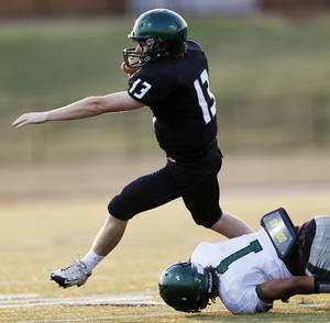 Photo - Norman North's Peyton Gavras (13) scrambles away from Edmond Santa Fe's Phillip Sumpter (1) during a high school football scrimmage at Moore Stadium between Edmond Santa Fe and Norman North in Moore, Okla., Thursday, Aug. 16, 2012. Photo by Nate Billings, The Oklahoman