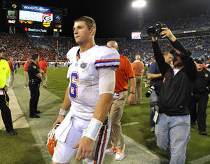 Photo -   Florida quarterback Jeff Driskel (6) walks off the field after their 17-9 loss to Georgia in an NCAA college football game, Saturday, Oct. 27, 2012 in Jacksonville, Fla. Georgia beat Florida 17-9. (AP Photo/Stephen Morton)