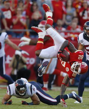 Photo - Kansas City Chiefs wide receiver Dwayne Bowe (82) is knocked down by Houston Texans free safety Shiloh Keo (31) during the first half of an NFL football game at Arrowhead Stadium in Kansas City, Mo., Sunday, Oct. 20, 2013. (AP Photo/Ed Zurga)