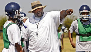 Photo - Star Spencer head coach Terrell Love talks with his players during football practice at Star Spencer High School on Thursday, Aug 12, 2010, in Oklahoma City, Okla.   Photo by Chris Landsberger, The Oklahoman