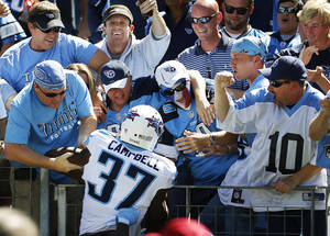 photo -   Tennessee Titans&#039; Tommie Campbell celebrates with fans after scoring a touchdown on a 65-yard punt return against the Detroit Lions in the first quarter of an NFL football game, Sunday, Sept. 23, 2012, in Nashville, Tenn. (AP Photo/Joe Howell)  