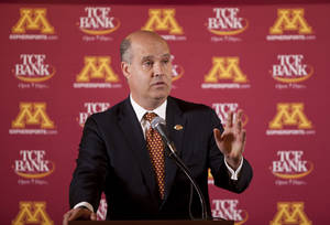Photo -   Norwood Teague speaks to reporters at a news conference Monday April 23, 2012 in the Gopher football locker room. in TCF Stadium in Minneapolis, Minn. Teague was introduced as the next director of athletics at the University of Minnesota. He previously held the same position at Virginia Commonwealth. (AP Photo/The Star-Tribune, Jeff Wheeler)