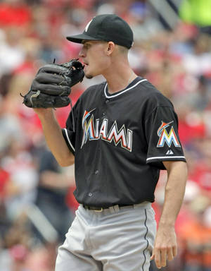Photo - Miami Marlins starting pitcher Andrew Heaney regroups after giving up back-to-back home runs in the fourth inning of a baseball game against the St. Louis Cardinals, Saturday, July 5, 2014, in St. Louis.(AP Photo/Tom Gannam)