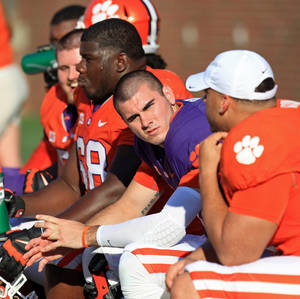 Photo - Clemson quarterback Chad Kelly, center, sits on the bench during the second half of the Tigers' NCAA college football spring game at Memorial Stadium in Clemson, S.C. on Saturday, April 12, 2014. Head coach Dabo Swinney announced on Monday, April 14,  that Kelly was dismissed from the team. (AP Photo/Anderson Independent-Mail, Mark Crammer) GREENVILLE NEWS - OUT; SENECA JOURNAL - OUT