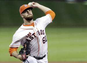 Photo - Houston Astros' Dallas Keuchel delivers a pitch against the Seattle Mariners in the first inning of a baseball game on Saturday, May 3, 2014, in Houston. (AP Photo/Pat Sullivan)