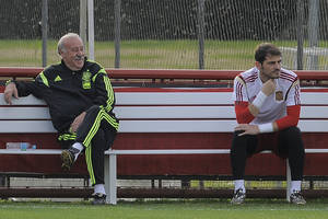 Photo - Spain's head coach Vicente del Bosque, left, and player Iker Casillas attend a training session at he Atletico Paranaense training center in Curitiba, Brazil, Saturday, June 14, 2014. Spain will play in group B of the Brazil 2014 World Cup. (AP Photo/Manu Fernandez)