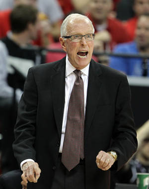 Photo - San Diego State head coach Steve Fisher instructs his team during the second half of a Mountain West Conference tournament NCAA college basketball game against Boise State on Wednesday, March 13, 2013, in Las Vegas. San Diego State defeated Boise State 73-67. (AP Photo/Isaac Brekken) ORG XMIT: NVIB149