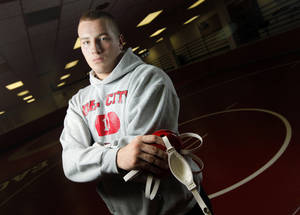 photo - Del City wrestler Josh McNaughton poses for a photo in the wrestling room at Del City High School in Del City, Okla., Wednesday, Jan. 18, 2012. Photo by Nate Billings, The Oklahoman